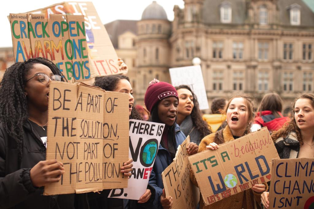 climate change protest with teenagers holding placards